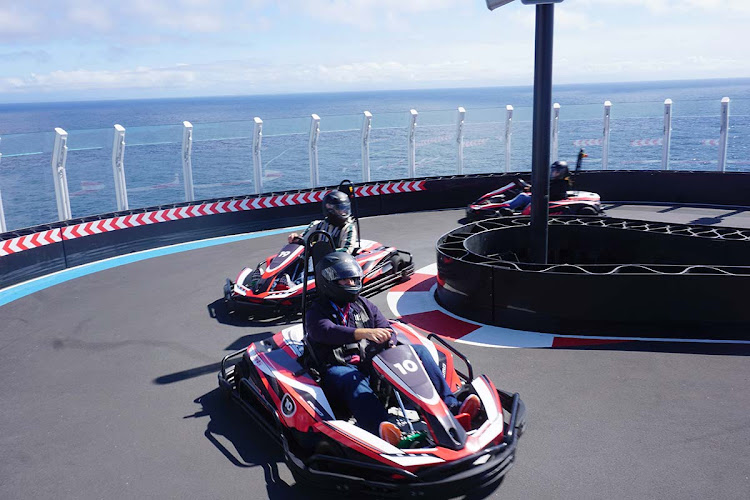 Go-karts can zoom around the two-story racetrack at speeds up to 30 mph. (Click to enlarge.)