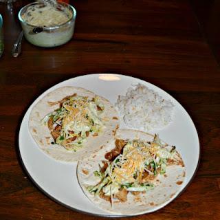 Shredded Pork Tacos with Pinto Beans and Slaw.