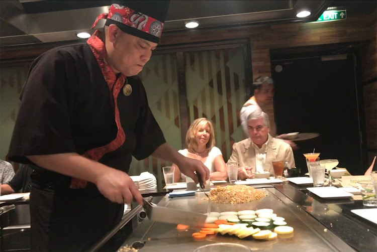Our teppanyaki chef prepares dinner on an open grill.