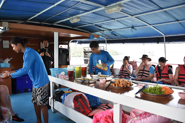 Enjoy a light lunch on the escort boat