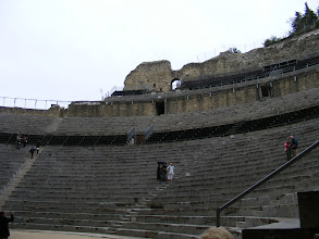 Photo: Here, a portion of the semicircular cavea, which held up to 9000 spectators (separated by social class). Roman citizens typically spent a large part of their free time there, as much of the entertainment (mime, pantomine, poetry readings and commedia dell'arte-style farces) lasted all day. The entertainment was open to all and without charge.