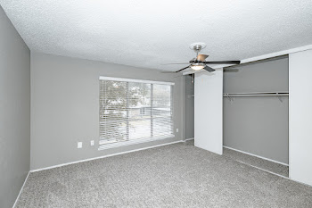 Three bedroom floorplan spacious bedroom with large window and closet