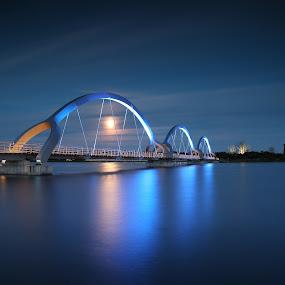 Illuminati by Joachim Persson - Buildings & Architecture Bridges & Suspended Structures ( illuminated, water, moon, reflection, blue, night, bridge, illuminati, longexposure )