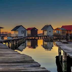 Houses at Sunset by Bela Paszti - Buildings & Architecture Places of Worship ( water, hungary, wooden, oroszlany, sunset, callm, lake, house, fishing, nikon, bokod,  )