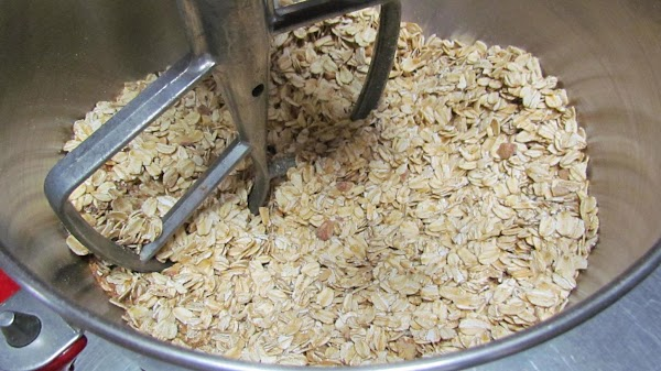 In a large bowl or kitchen aid mixer, combine the oats,  Flax seed,...