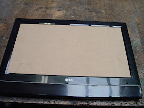 Photo: A piece MDF wood was fit in from behind where the screen goes.