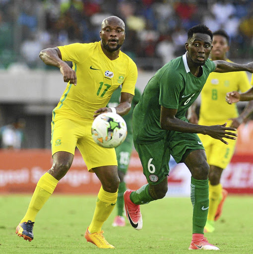 Big signing: Tokelo Rantie, left, in action for Bafana Bafana against Nigeria's Wilfred Ndidi in a Nations Cup qualifier in June 2017. Picture: KABIRU ABUBAKAR/GALLO IMAGES