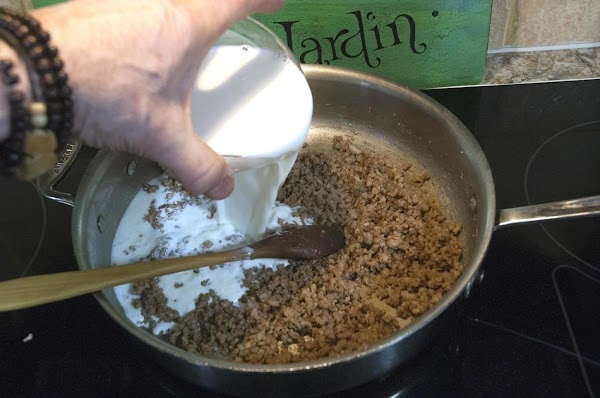 Pour 1.5 cups of the milk into the pan.