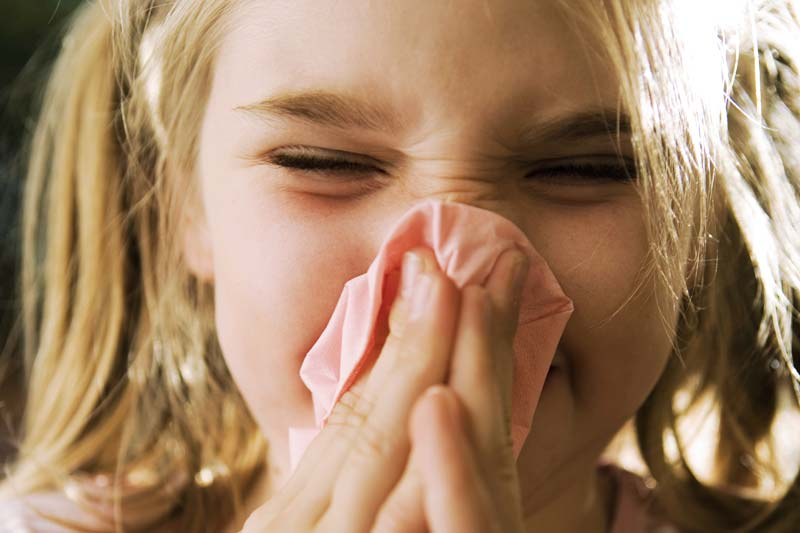 A child with runny nose.