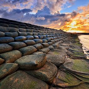 Barricade by Hendri Suhandi - Landscapes Beaches ( sack, sand, sunset, beach, sunrise )