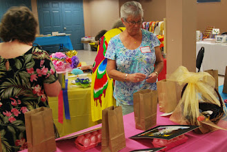 Photo: Grannies take time to decide how to spend tickets on draw items.