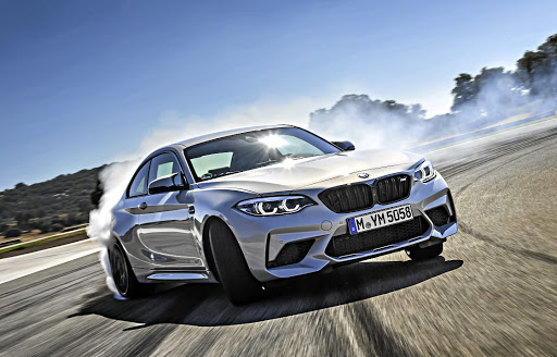 The M2 Competition has as happy spinning its rear wheels on the track as barreling through a twisty series of corners. Picture: BMW