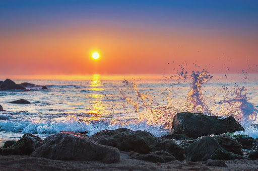 Cuba-Sunset-with-Waves-Crashing-on-Rocks.jpg - Sunset on a Cuban beach.