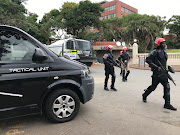 Mi7 tactical unit security guards patrolling at the University of KwaZulu-Nata's Howard College campus on Friday after protesting students burnt down the guardhouse.
