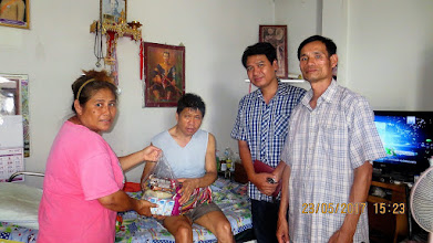 Photo: Chai Prakan: House to call HIV patient who recently had bicycle accident with Gee and healthcare workers, Aoy and Yongyut.