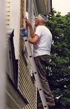 Photo: Gordon scraping his house.