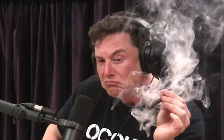 Elon Musk smoking a joint on a podcast hosted by the comedian Joe Rogan.