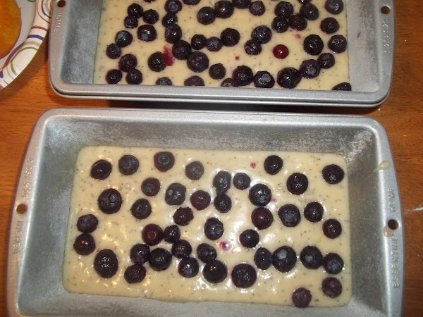 Grease and flour bread pans.Pour mixture into prepared bread pans; sprinkle blueberries on the...