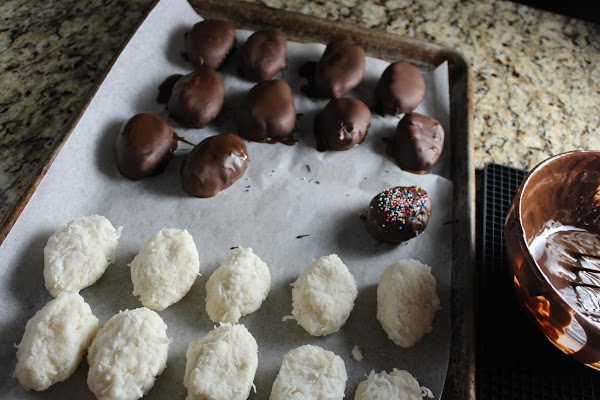 Take out a small batch and dip into chocolate. I shake them to get...