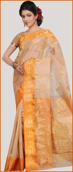 Photo: Fawn and Light Orange Bengal Handloom Pure Tussar Silk Saree with Blouse  Item Code: STR37  Price: US$ 88.34  Shop Now @ http://www.utsavfashion.com/store/sarees-large.aspx?icode=str37