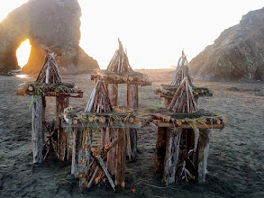 Photo: The tower platforms were first covered with beach grass then beach sand to create a stage for the teepee fires.