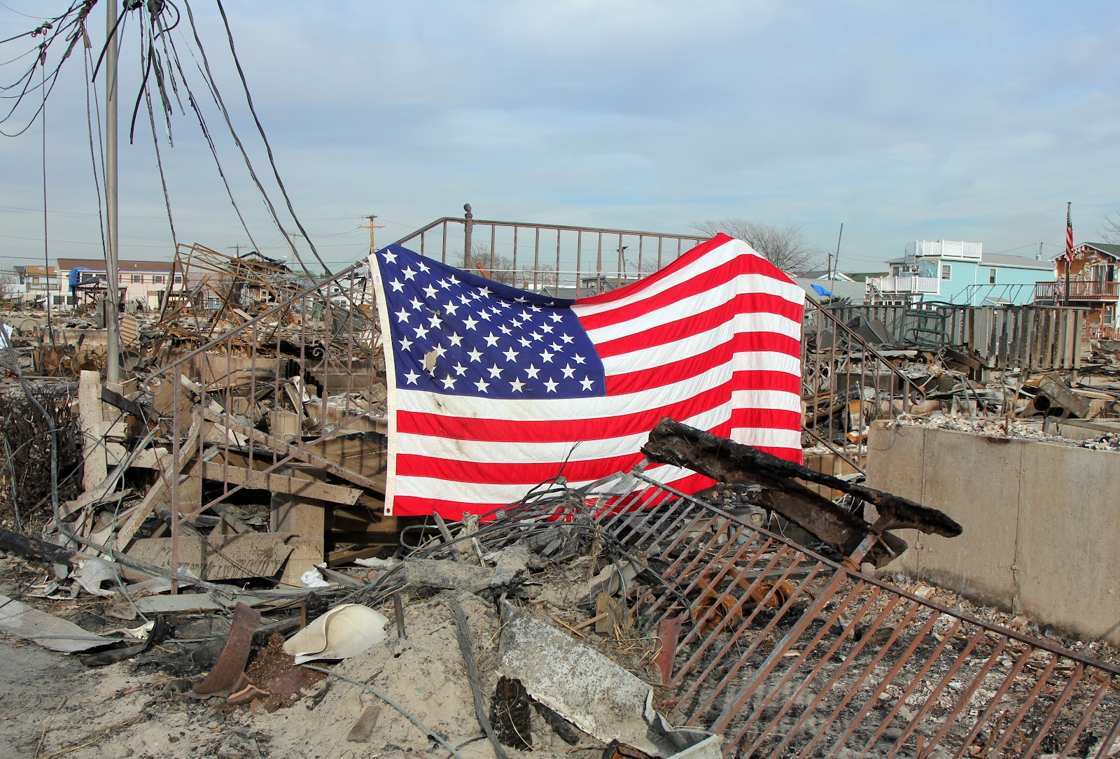 The American flag displayed on top of a pile of wreckage