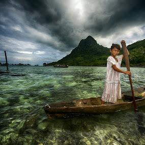 Little Boating Girl by Siew Jun Han - Babies & Children Children Candids ( child, boating, girl, dramatic, sea, ocean, landscape, boat, portrait )