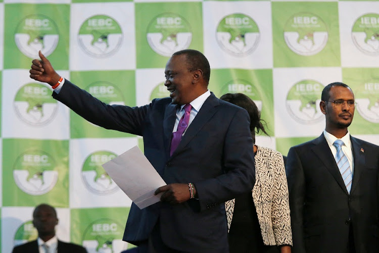 Incumbent President Uhuru Kenyatta reacts after he was announced winner of the presidential election at the IEBC National Tallying centre at the Bomas of Kenya, in Nairobi on Friday.  Picture: REUTERS/THOMAS MUKOYA
