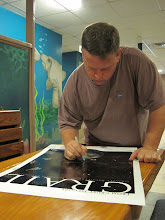 Photo: Chris signs a poster that will be given to the NASA social media team.
