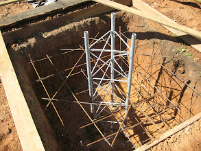 Photo: Next step is to get a 10' mid-section on this, and leveled.  and fastened with 2x4's so that the concrete pour on Monday 9/28/09 will not move the tower base off level.  No rebar is touching the tower.