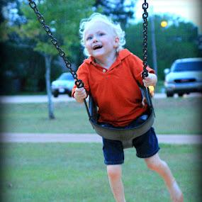 Boy in a swing. by Jay Rives - Babies & Children Children Candids ( playground, blond hair boy, candid, swing, boy )