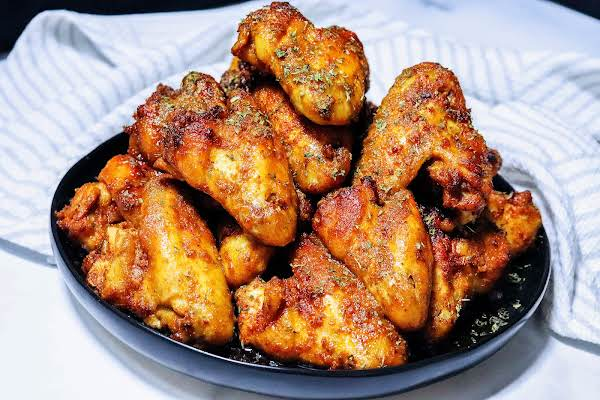 A Plate Of Butter Baked Chicken Wings.