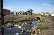 The SA Human Rights Commission joined residents on a walk-about to identify problems in Kliptown, where raw sewage flowing down the streets is a common sight.