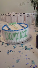 Photo: Gentleman themed baby shower cake - smooth white icing w/button down collared shirt & suspenders design on top.