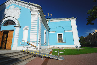 Photo: Ramp with handrails allows access up stairs into this Russian museum.