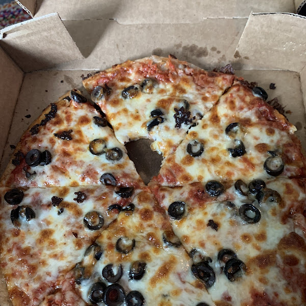 Gluten free personal pizza with extra cheese and black olives