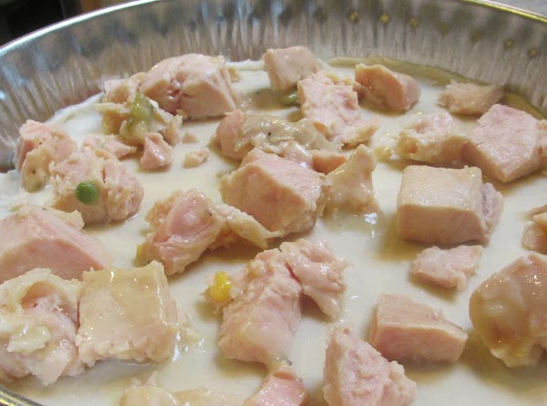 Drain canned Chicken breast and add to pie dish.
