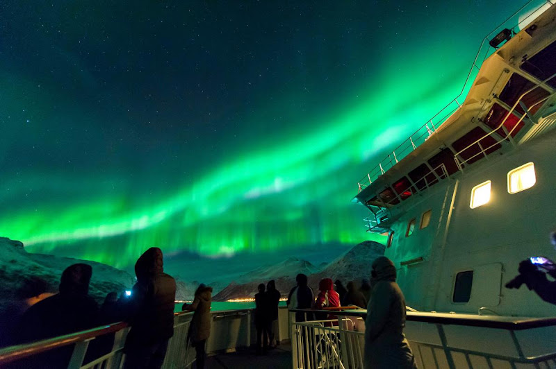 The Northern Lights over the Norwegian fjords, as seen on a Hurtigruten cruise.