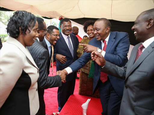 President Uhuru Kenyatta after delivering the State of the Nation address to Parliament on March 26, 2015. With him are Deputy President William Ruto, Senators James Orengo, Hassan Omar, Moses Wetang'ula and Taveta MP Naomi Shaban