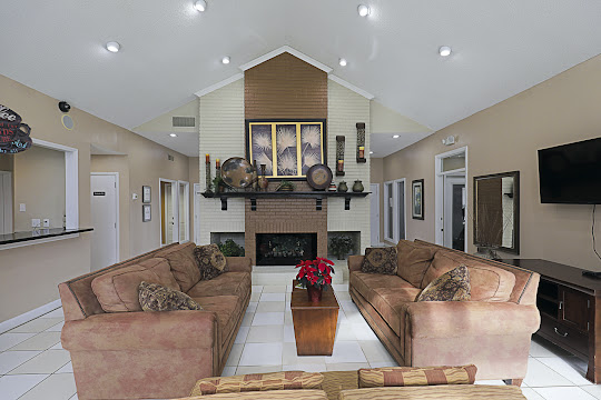 Clubhouse with tile flooring, fireplace and seating