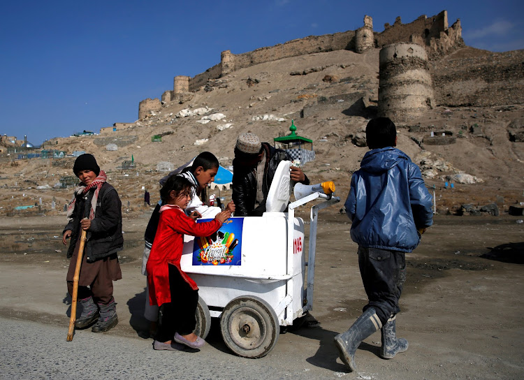 Children buy ice cream in Kabul, Afghanistan.
