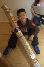 Photo: a happy boy with his rocket