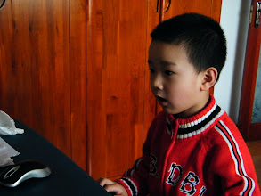 Photo: baby playing game.