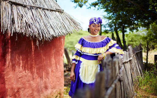 A local woman in traditional dress poses in Bonaire.