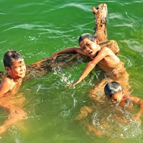 Cheerful children in a lake Singkarak by Syafriadi S Yatim - Babies & Children Children Candids