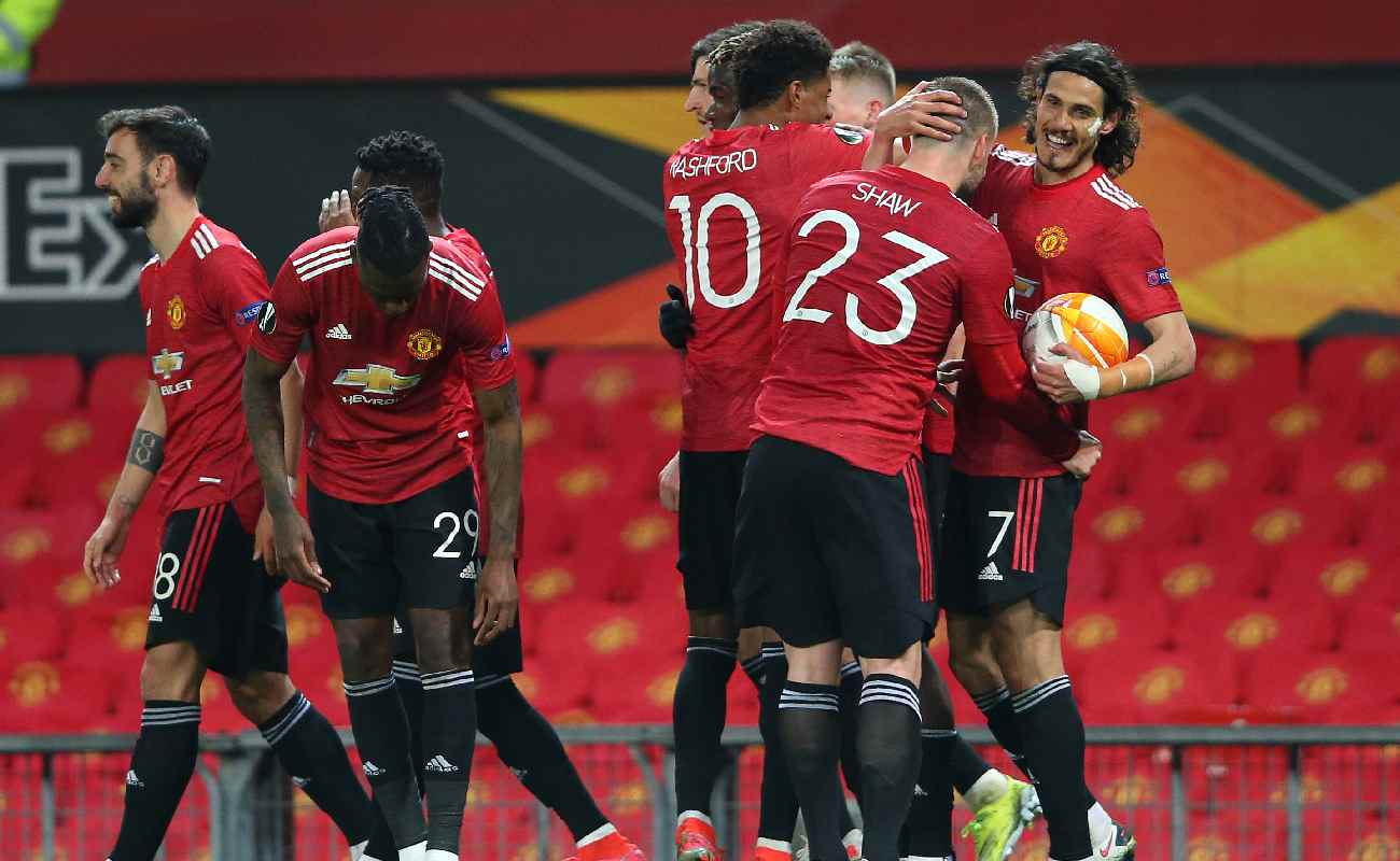 Alt: Manchester United celebrate after scoring their 5th goal against Roma - Photo by Alex Livesey - Danehouse/Getty Images