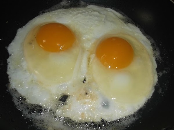 Break each egg into prepared skillet; cook over medium/medium-high heat for 1 1/2 minutes;...