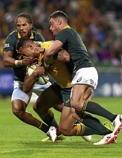 Bok wing Courtnall Skosan, left, and centre Jesse Kriel stop Australian fullback  Israel Folau in his tracks in Perth on Saturday. Picture: PAUL KANE/ GETTY IMAGES