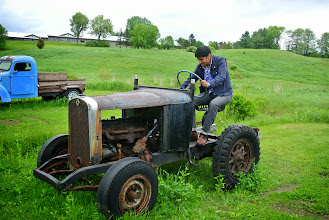 Photo: Feraz found a tractor and wished he was back in Pakistan.