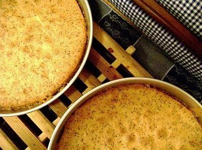 Fold in the beaten egg whites. Pour equally into the prepared pans. Bake for...